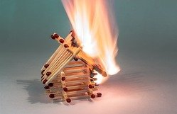 house made from matches on fire