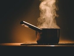 boiling pot on stove with steam