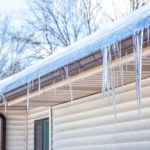 rain gutter with ice and snow