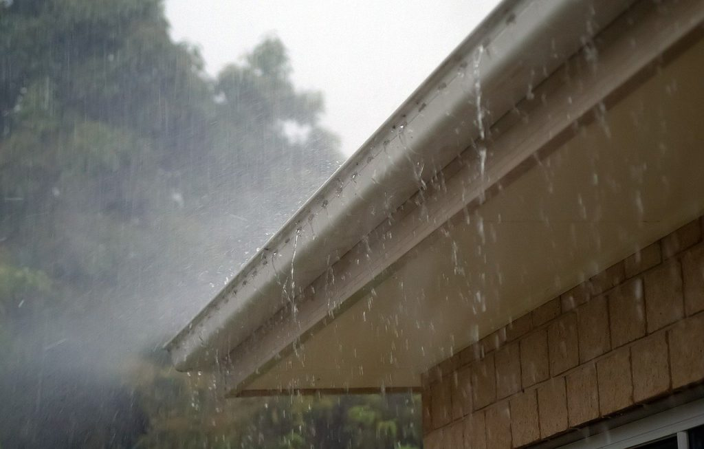 fixing overflowing rain gutter