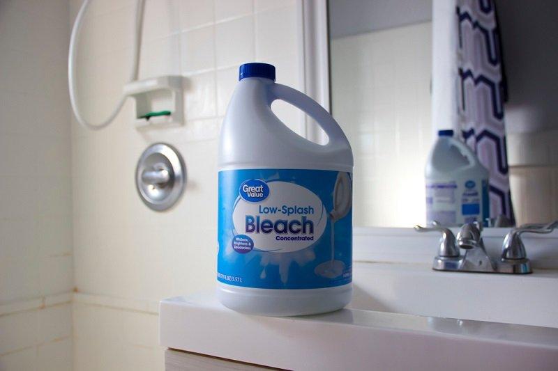 pouring bleach down drain