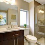 bathroom mirror installed above sink