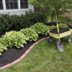 wheelbarrow full of mulch on green grass