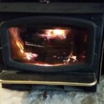 wood burning in a wood stove fireplace