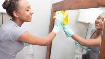 cleaning an anti fog bathroom mirror to keep it fog free