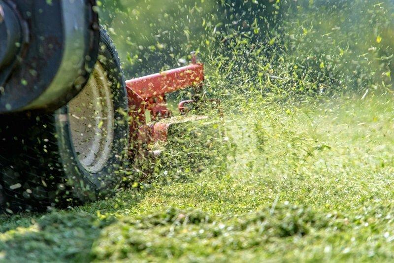 grass clippings sticking under mower deck