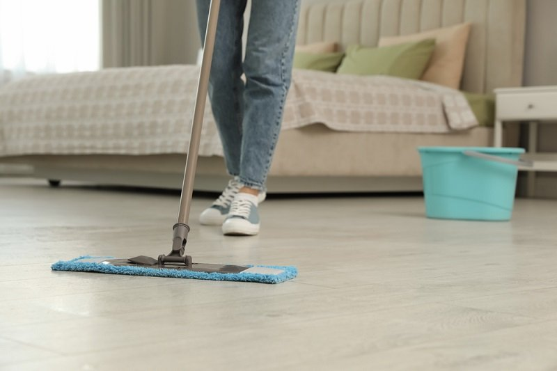 person cleaning floors
