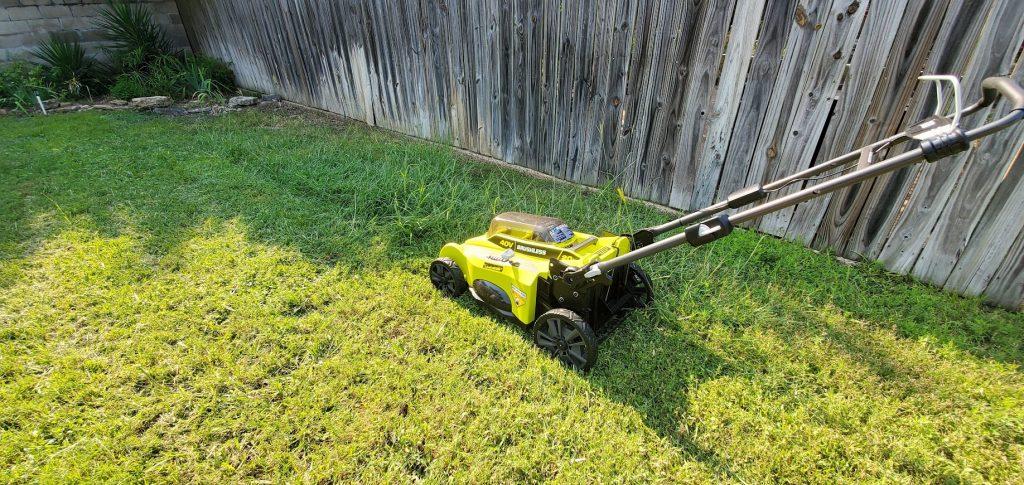 ryobi 20 inch 40 Volt walk behind mower in tall grass